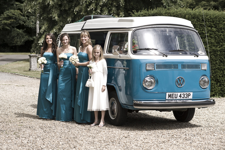 Formal wedding photo of three bridesmaids with a younger maid of honour infant of a VW camper van, Somerset