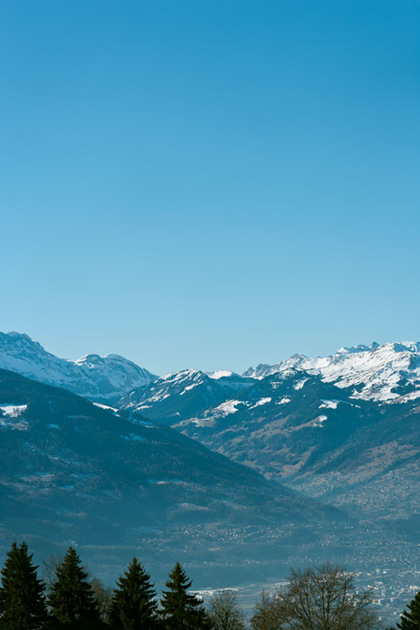 a photo of the Alps on a sunny day