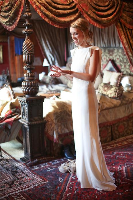 Stunning Somerset bride in her wedding dress smiling at her engagement ring