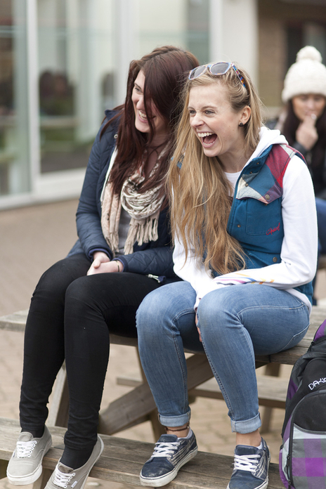 laughing university students on campus pose for photographer dorset