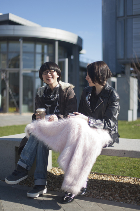 international students sit together on campus photo