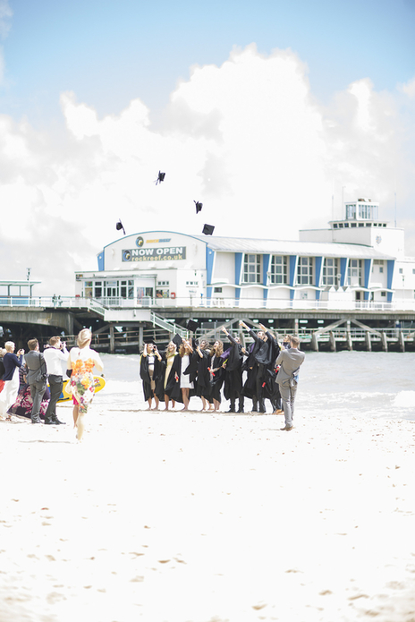 Bournemouth beach and pier at graduation time with students getting their photo taken