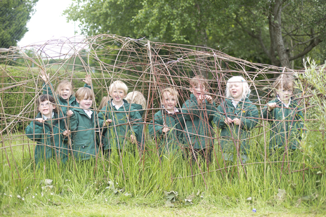 a group of somerset school children pose for photographer