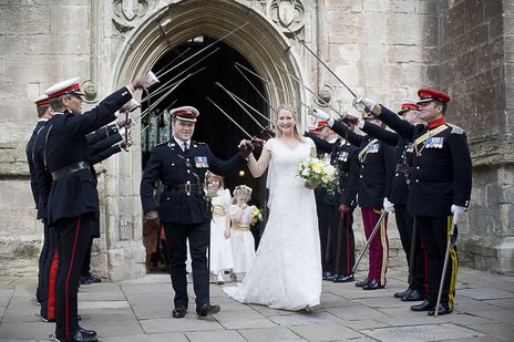 Military wedding in the Cotswolds, bridge and groom exit the Abbey