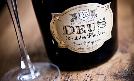 photo of deus bottle and glass