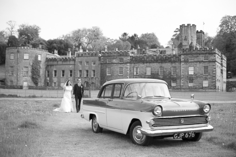 Classic car and wedding couple at Port Eliot House, Cornwall