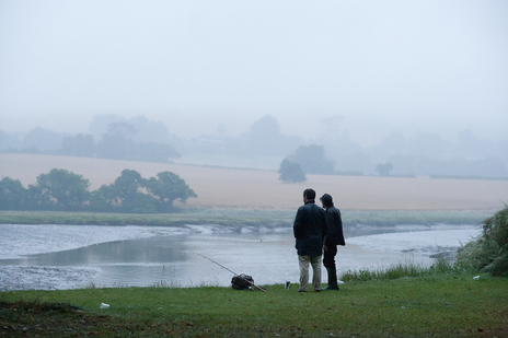 cold morning photograph by the river of two men fishing, Cornwall