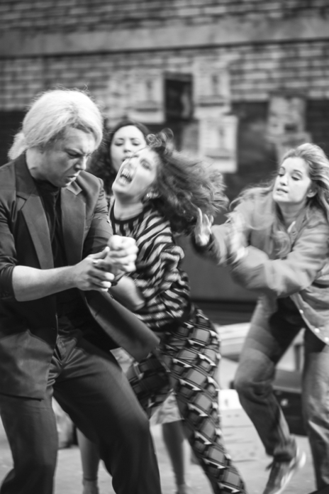 black and white action photo of actors shouting and pushing
