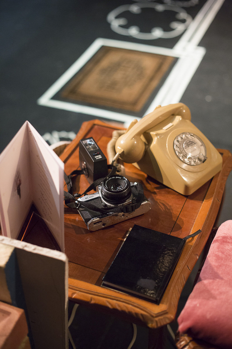 set design still showing a camera and a telephone