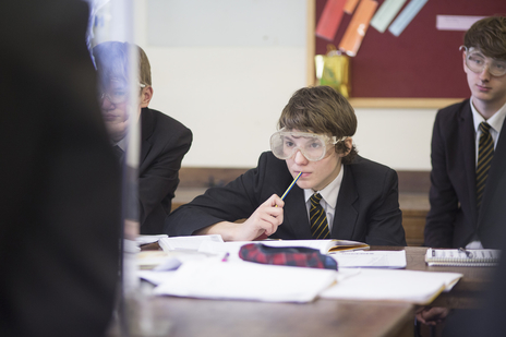 schoolboy in classroom studying science somerset