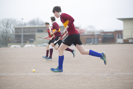 sports photo of students playing hockey in somerset