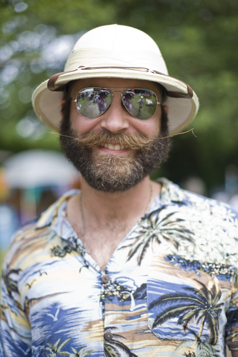 photograph of world moustache champion posing at a festival