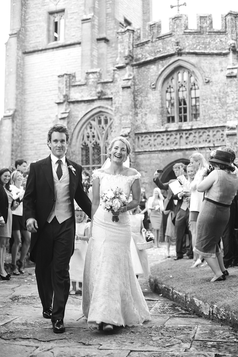 Traditional wedding photo of bride and groom leaving the church Curry Rival, Somerset