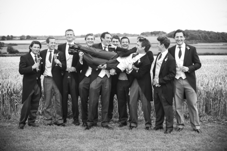 the boys hoist groom up to pose for wedding photographer in Somerset