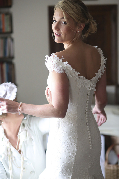bride checking reverse of dress in a Somerset wedding photo