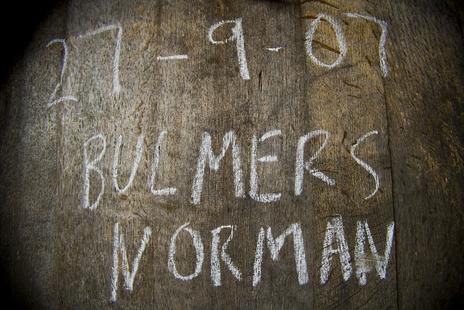 Bulmers Norman written in chalk on end of wooden barrel photo