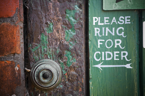 doorbell with 'please ring for cider' instructions painted next to it photo