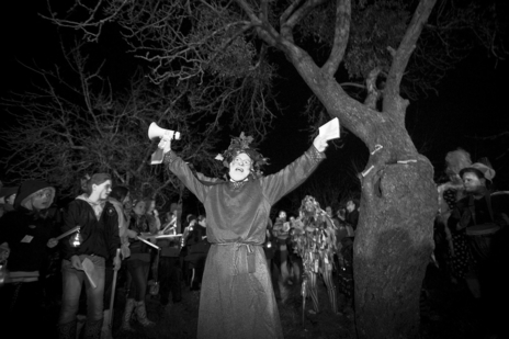 druid with a megaphone shouts at a cider celebration