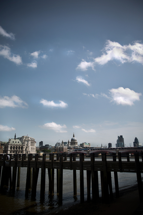 view of London over a pier on river thames photo