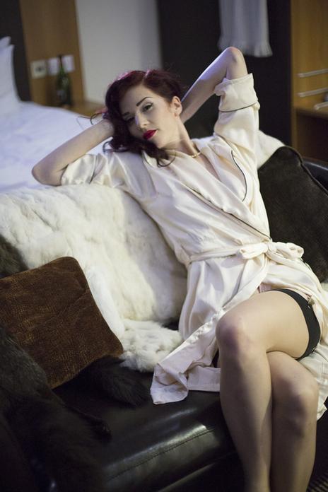 missy fatale lying back posing in sofa