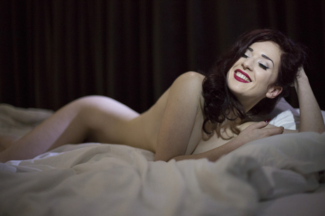 missy fatale on bed smiling nude looking very alluring