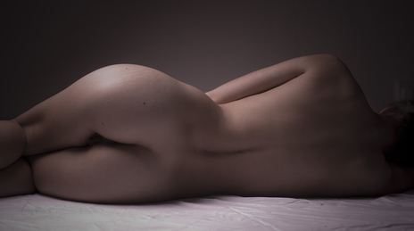 anonymous nude lying on side posing