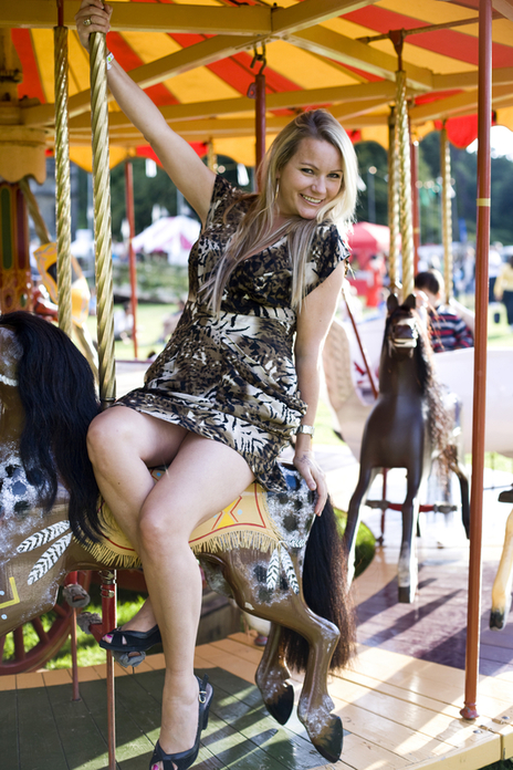 woman on merry go round photo cornwall festival