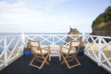 tourism photo devon of deckchairs overlooking sea