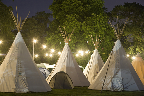 Photograph of posh camping tee pees and bell tents at Port Eliot festival, Cornwall