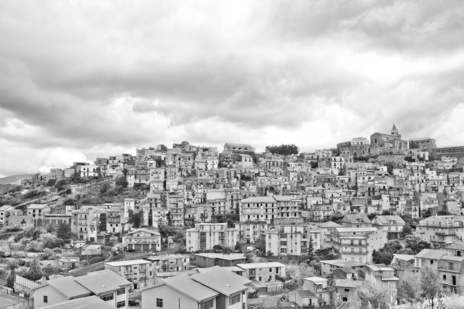 Black white travel tourism photograph of Sicily hillside town