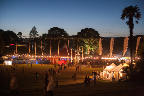 Festival photo of banner blowing at sunset, Port Eliot Festival, Cornwall