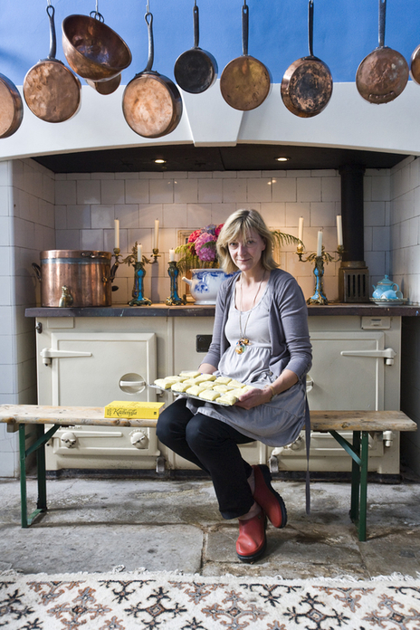 photo of cookery writer Rose Prince sitting in a kitchen with baking