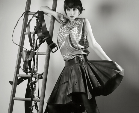 studio fashion photo with saddlery