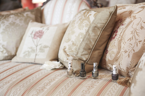 wedding photo of nail polish bottles on a sofa