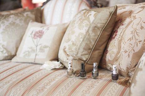 wedding photo of nail polish bottles on a sofa