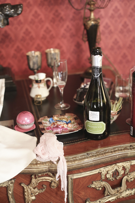 Champagne, glasses and gifts detail at a Somerset wedding