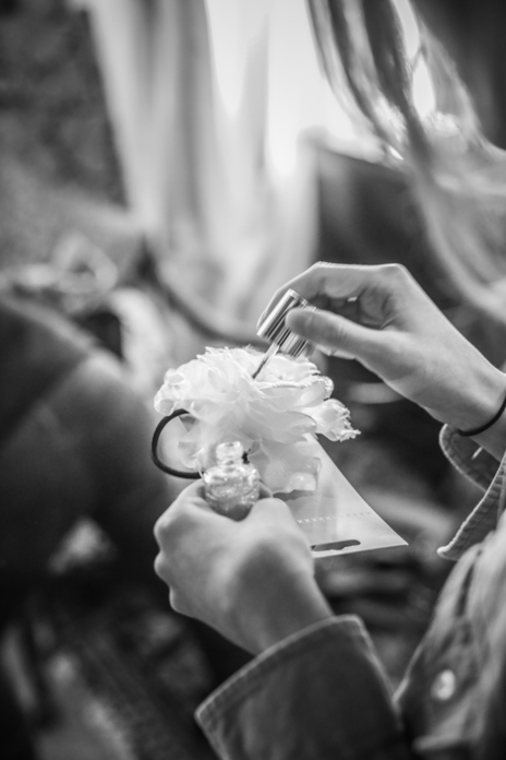 photo of glitter being painted onto a flower for a wedding