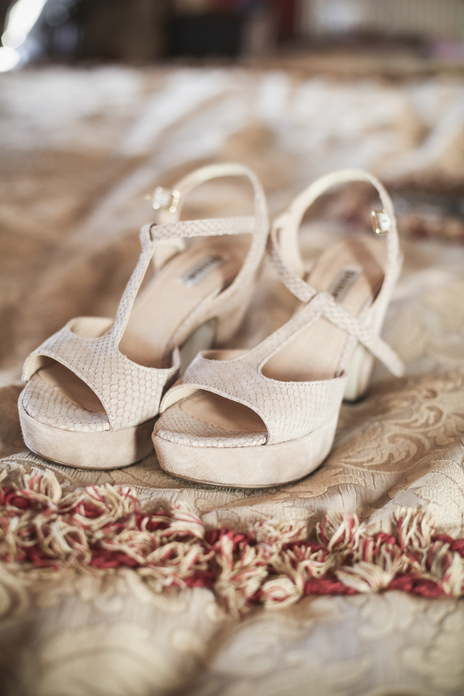 brides wedding shoes on bed Maunsel House somerset photo