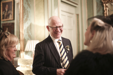 father of the groom laughing in a wedding photograph