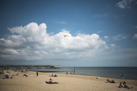 Photo of sunny Bournemouth beach scene, tourism in Dorset