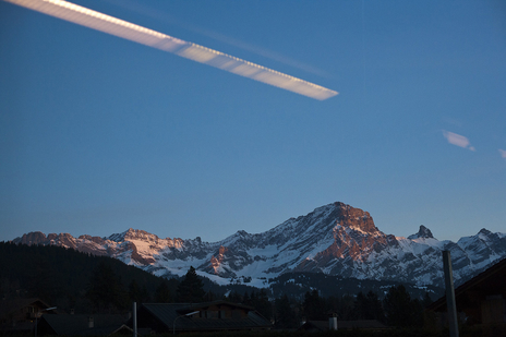 photo of view of the alps with reflections on glass