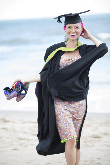 fashion designer Twinks Burnett posing at her graduation on the beach