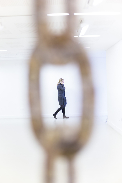 photo of woman on her phone in an art gallery