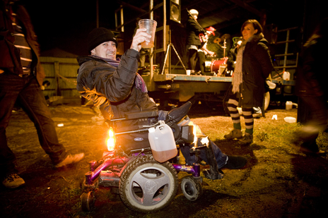 disabled man in wheel chair celebrating cider at a wassail