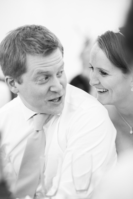 bride and groom laughing on their wedding day somerset