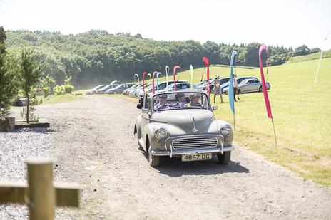 photo of morris car driving to wedding venue