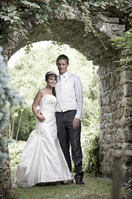 young married couple pose for wedding photograph in Somerset