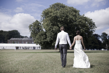married couple walk away from somerset wedding photographer