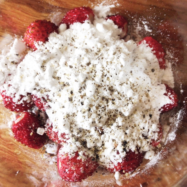 icing sugar, cider eau de vie and wild strawberries in a jar