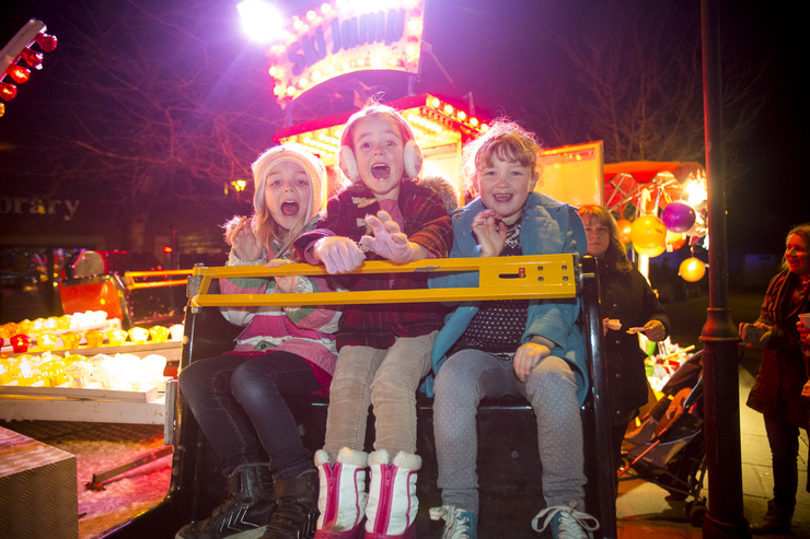 Children on christmas fair ride tourism photo